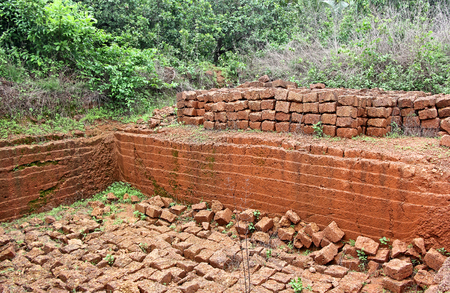konkan: Quarry of laterite stone, a soft rock widely used as building material of old forts and houses in Goa and Konkan region, India. Stock Photo