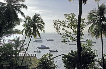 paula: Sunrise scene of tourist, fishing and speed boats anchored in the bay at Dona Paula in Goa, India. Stock Photo