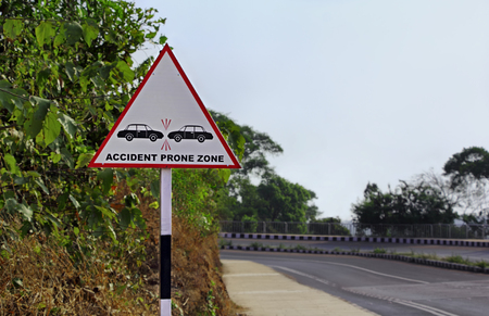 Road sign warning motorists to be careful at a zone prone to possible accidents and collisions in a hill highway