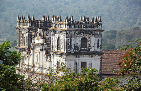 The spires of Saint Anne Church, Santana Church, a 17 th century church in Portuguese baroque style, in Talaulim, Goa, India, where Touxeachem Feast or Cucumber Festival is held in the July month Stock Photo