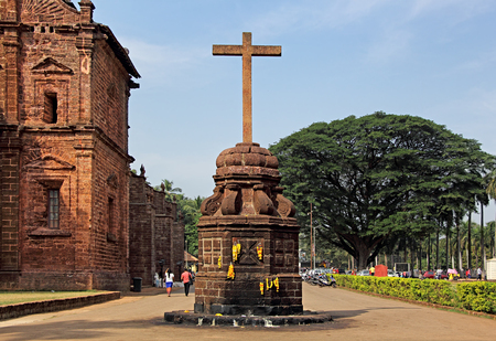 Goa, India - December 27, 2015: The main holy cross outside the historic Basilica of Bom Jesus in Old Goa, India, a UNESCO World Heritage Site where the mortal remains of St Francis Xavier is kept