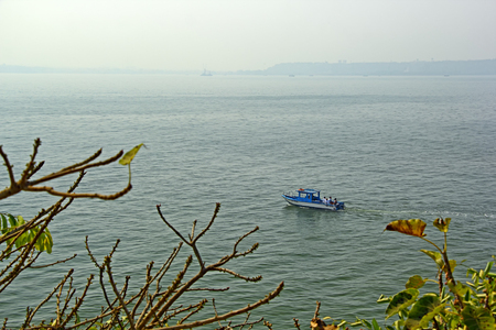to paula: Dona Paula, Goa, India - February 10, 2017: Unidentified sport anglers in boat on an angling trip in the sea around Dona Paula in Goa, India.