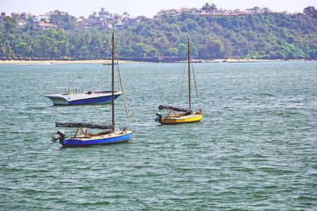 to paula: Morning scene of three boats anchored in outer sea in Dona Paula in Goa, India Stock Photo