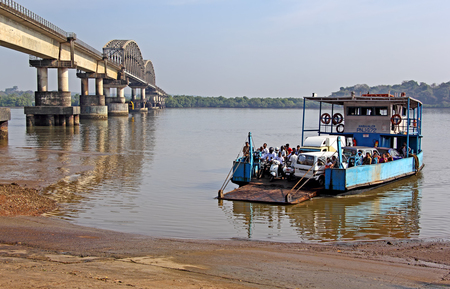 Goa, India - March 05, 2017: Ferry boat transfers passengers and vehicles across the Zuari River in Goa, India. Ferry boats are used where there is no bridge connectivity.