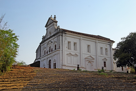 Our Lady of the Mount Chapel with the ramp staircase in laterite stones in Monte Hill in Old Goa, India. Every February the Monte Music Festival is held here. Imagens