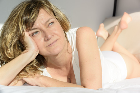 Beautiful woman meditating on future plans Stock Photo