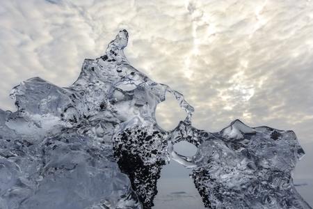 Block of ice melting on the beach