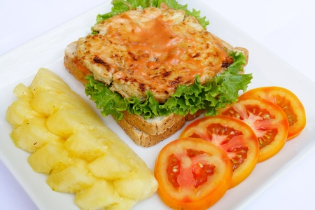 A delicious hamburger with tomato and pineapple photo