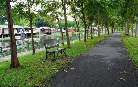 The park after rainy close by the edge of the canal village photo
