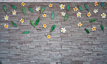 The dark black wall with ceramic flower photo
