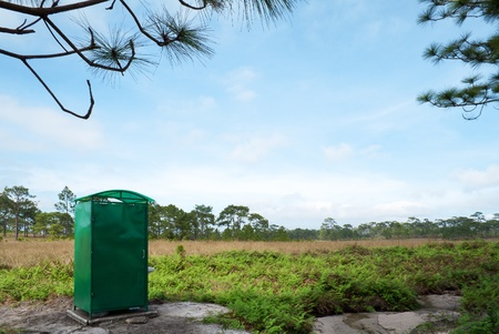 Public toilet in pine oak savanna forest photo