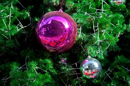 Sphere balls are decorated on Christmas tree photo