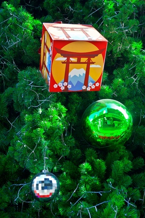 Sphere balls and box are decorated on Christmas tree photo