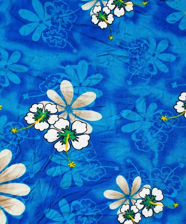 Close shot of blue clothing full with flowers pattern photo