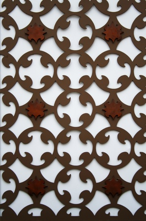 A new perforated pattern metal plate on a wall Stock Photo - 12579299