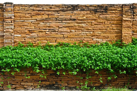 A decorative stone wall isolated on white background Stock Photo