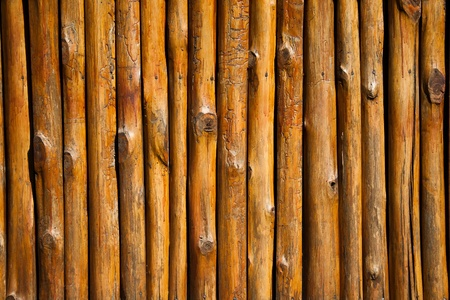Thai traditional style wall made from trunk of trees