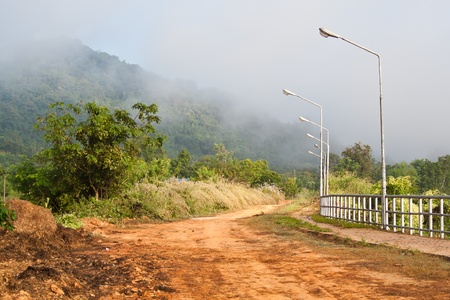 The Thai countryside landscape view of the road in the morning photo