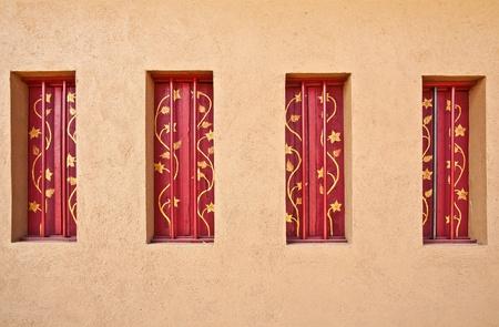 banister: Designed windows of vintage house