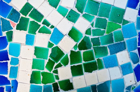 Mosaic wall decorative ornament from broken ceramic tiles photo