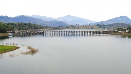 longest: The longest wooden bridge in Thailand isolated on white sky Stock Photo