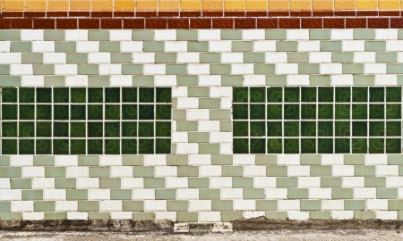 Decorative wall with ceramic tiles and glass block photo