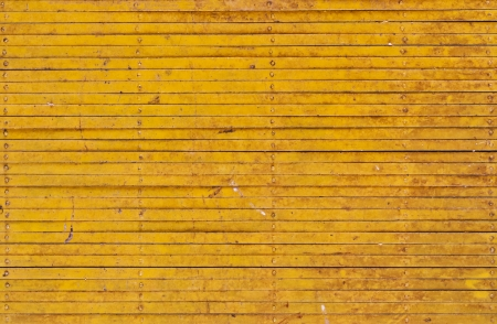 Yellow iron fence photo