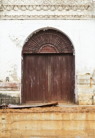 Antique wood door and white wall Stock Photo - 14230917