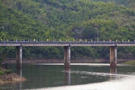 Concrete bridge across river with mountain background photo