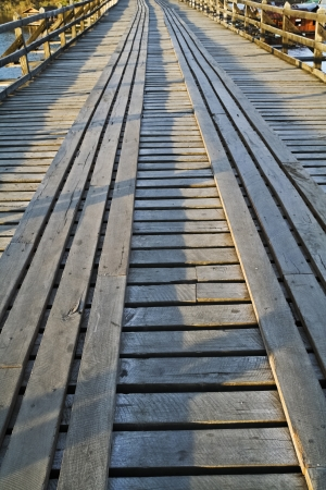 Conceptual image of wooden pathway in the evening Stock Photo - 14230931