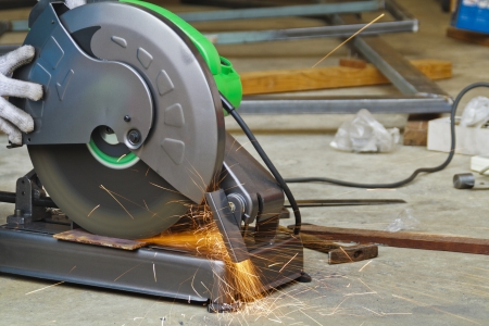 Construction working with cutting grinder photo