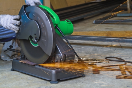 Construction working with cutting grinder