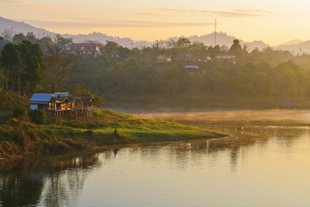 lake dwelling: Riverside residence at countryside in Thailand Stock Photo