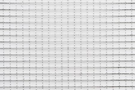 Conceptual image of Iron net and white concrete wall photo