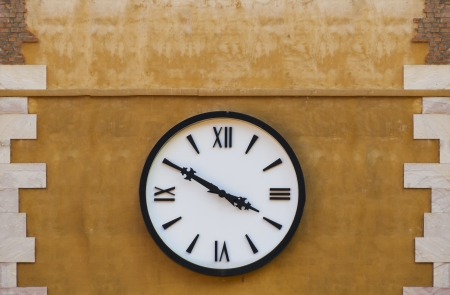 Retro clock on a wall photo