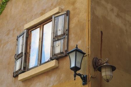 Retro window, lamp and wall photo