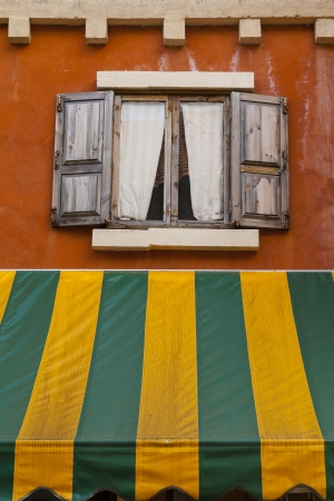 Vintage window and protection extending from the eaves Stock Photo - 14841944