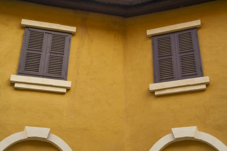 Vintage windows and yellow wall photo