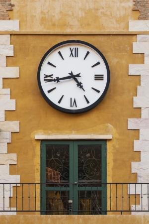 Retro clock on a building photo