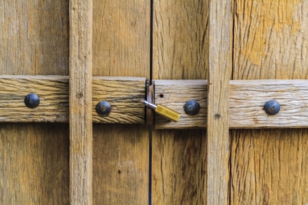 Conceptual image of wood door with lock photo