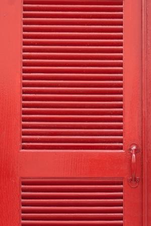 louver boards: Red vintage wooden door
