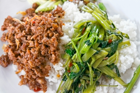 Cooked rice with minced pork fried in shrimp paste and morning-glory vine fried in garlic, chili and bean sauce photo
