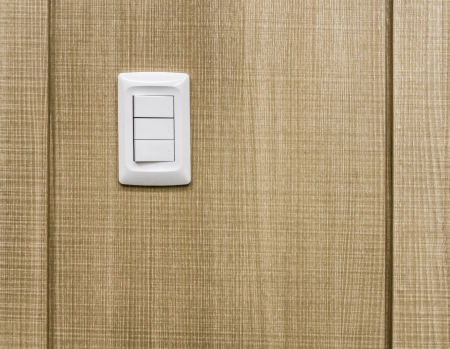 Electrical switches on wooden wall photo