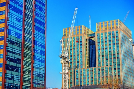 Building crane and modern building in the city photo