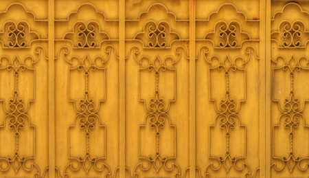The yellow pattern on metallic gate photo
