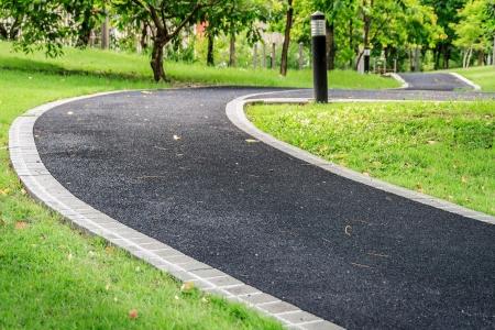 Asphalt footpath in public garden