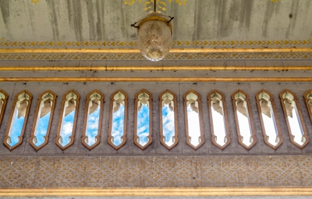 Windows and electrical lamp in temple hall photo