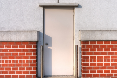Concrete brick wall and a metal door Stock Photo - 22971417