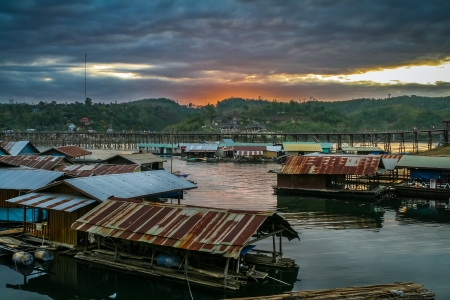 The floating village and longest Mon wooden bridge of country in Sangkhlaburi, Kanchanaburi province in Thailand photo