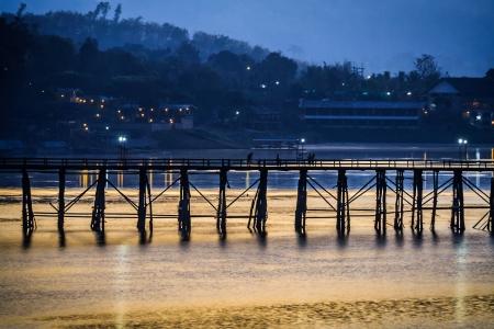 longest: Uttamanusorn Bridge,Saphan Mon,  the countrys longest Mon wooden bridge in Sangkhlaburi, Kanchanaburi province in Thailand Stock Photo